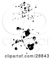 Two Black Ink Blots And Drips On A White Background