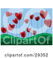 Red Heart Flowers Growing In A Green Hilly Landscape Symbolizing A Growing Love
