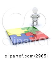 Clipart Illustration Of A White Character Standing Proudly Over A Completed Colorful Puzzle