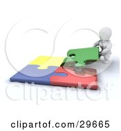 Clipart Illustration Of A White Character Crouching To Fit The Last Piece Of A Colorful Jigsaw Puzzle