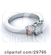 Silver Wedding Or Engagement Ring With A Diamond And Two Gemstones Resting On A White Surface