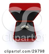 Golden Wedding Or Engagement Ring With A Diamond And Two Gemstones Inside An Open Red Box