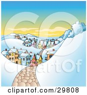 Clipart Illustration Of A Snowy Cobblestone Road Leading Through A Hilly Village With Colorful Buildings In The Winter