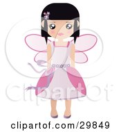 Black Haired Caucasian Fairy Princess In A Pink Dress And Wings