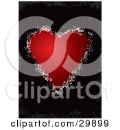 Red Valentines Day Heart With Grunge Spots Bordering It Over A Gray Grunge Background