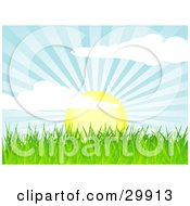 Clipart Illustration Of The Sun Rising Over Green Grass Casting Rays Of Sunshine In The Sky