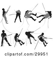 Series Of Silhouetted Rock Climbers Using Ropes And Climbing Techniques To Descend And Ascend A Mountain