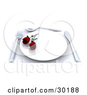 Place Setting With Two Red Roses On A Plate A Fork Spoon And Knife