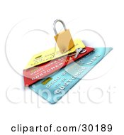 Keys Resting Beside A Secured Padlock On Top Of Yellow Red And Blue Credit Cards