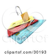 Keys Resting Beside An Open Padlock On Top Of Yellow Red And Blue Credit Cards