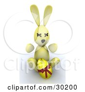 Yellow Bunny Rabbit Sitting With A Gold Easter Egg