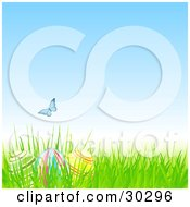 Clipart Illustration Of A Blue Butterfly Over Three Easter Eggs Hidden In Grass Under A Blue Spring Sky