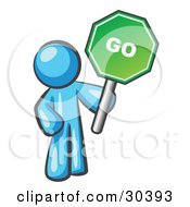 Clipart Illustration Of A Light Blue Man Holding Up A Green Go Sign On A White Background by Leo Blanchette