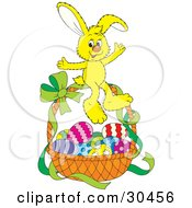 Cute Yellow Bunny Rabbit Sitting On Top Of A Basket Of Easter Eggs With A Green Ribbon On The Handle by Alex Bannykh