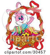 Friendly Pink Bunny Rabbit Waving And Standing Behind A Basket Of Colorful Easter Eggs