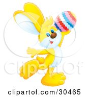 Clipart Illustration Of An Adorable Yellow Rabbit Holding Up An Easter Egg And Dancing