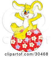 Energetic Yellow Bunny Rabbit Sitting On Top Of A Big Red Floral Patterned Easter Egg by Alex Bannykh