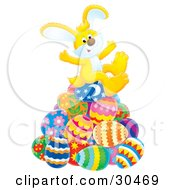 Clipart Illustration Of A Cute Yellow Bunny Rabbit Sitting Atop Of A Pile Of Colorful Easter Eggs