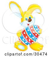 Clipart Illustration Of A Cute Yellow Rabbit Holding A Floral Patterned Easter Egg
