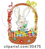 Clipart Illustration Of An Adorable Gray Bunny Rabbit Hugging A Carrot And Standing Behind A Basket Of Colored Fruits And Veggies