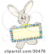 Clipart Illustration Of A Friendly Little Rabbit Holding A Blank Sign