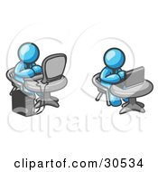 Clipart Illustration Of Two Light Blue Men Employees Working On Computers In An Office One Using A Desktop The Other Using A Laptop