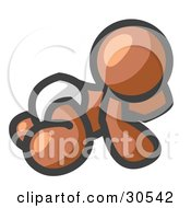 Poster, Art Print Of Brown Baby In A Diaper Crawling On The Floor On A White Background