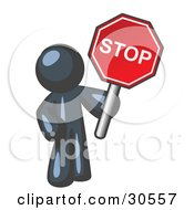 Clipart Illustration Of A Navy Blue Man Holding A Red Stop Sign by Leo Blanchette