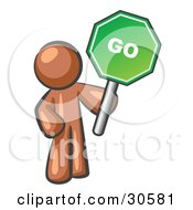 Clipart Illustration Of A Brown Man Holding Up A Green Go Sign On A White Background by Leo Blanchette
