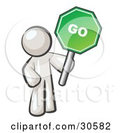 Clipart Illustration Of A White Man Holding Up A Green Go Sign On A White Background by Leo Blanchette