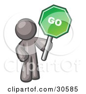 Clipart Illustration Of A Gray Man Holding Up A Green Go Sign On A White Background by Leo Blanchette