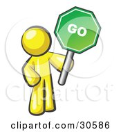 Clipart Illustration Of A Yellow Man Holding Up A Green Go Sign On A White Background