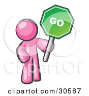 Clipart Illustration Of A Pink Man Holding Up A Green Go Sign On A White Background by Leo Blanchette