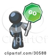 Clipart Illustration Of A Navy Blue Man Holding Up A Green Go Sign On A White Background by Leo Blanchette