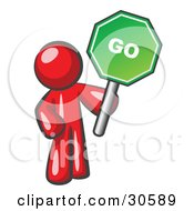 Clipart Illustration Of A Red Man Holding Up A Green Go Sign On A White Background