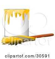 Wood Handled Paintbrush With Yellow Paint On The Bristles Resting In Front Of A Can Of Yellow Paint