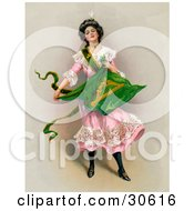 Clipart Illustration Of A Vintage Victorian St Patricks Day Scene Of A Young Lady In A Pink Dress Holding The Traditional Irish Flag Circa 1903