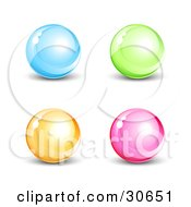 Clipart Illustration Of A Set Of Four Blue Green Orange And Pink Shiny Marbles Or Orbs