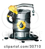 Yellow Dripping Petrol Nozzle Emerging From A Barrel Of Gasoline