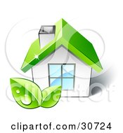Two Dewy Green Leaves In Front Of A Small White Home With A Big Window And A Green Roof