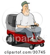 White Man Operating A Red Riding Lawn Mower While Landscaping