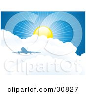 Blue Silhouetted Airplane Above Puffy White Clouds In A Blue Sky With A Sun And Rays Of Sunshine