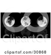 Clipart Illustration Of A 3d Rendered Line Of Three Black And White Grid Globes Reflecting On A Black Surface