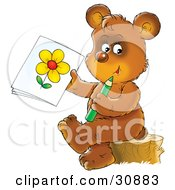 Artistic Brown Bear Cub Sitting On A Tree Stump And Holding Up A Drawing Of A Flower
