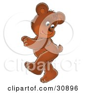 Clipart Illustration Of A Cute Brown Bear Cub Doing A Happy Dance Looking Back At His Tail