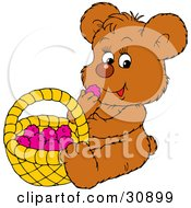 Cute Little Brown Bear Eating Healthy Snack Raspberries From A Basket