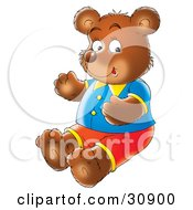 Bear Dressed In Clothing Sitting On The Ground And Smiling