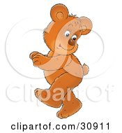 Clipart Illustration Of An Energetic Bear Cub Looking Back At His Tail While Doing A Happy Dance