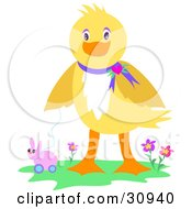 Friendly Yellow Easter Duck Playing With A Rolling Bunny Toy And Standing In Flowers