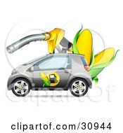 Silver Compact Car With A Corn Biofuel Label On The Door Under A Giant Gas Nozzle With Ears Of Corn